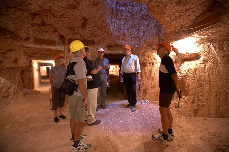 group wearing hard hats in a coober pedy opal mine